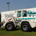 Forklift parked in front of adkins trailer